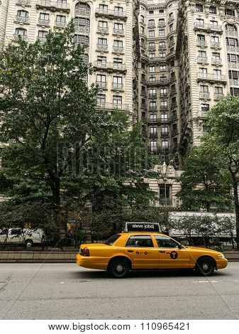 The Ansonia Building And Taxi On The Street