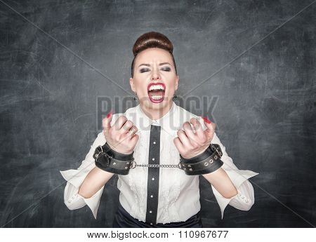 Freedom Concept. Screaming Business Woman With Handcuffs