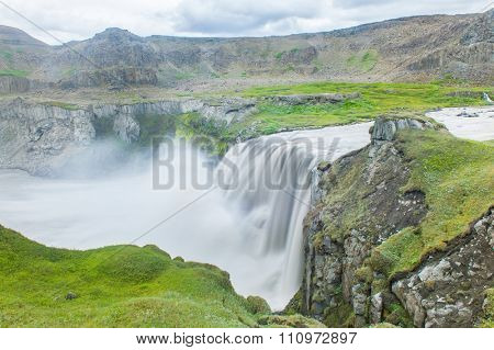 Hafragilsfoss is the very powerful waterfall on Iceland not far from its bigger brother Dettifoss. It is located in Jokulsargljufur National Park the northeasten Iceland on river Jokulsa a Fjollum.