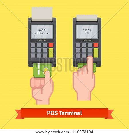 Hand inserting credit card to a POS terminal