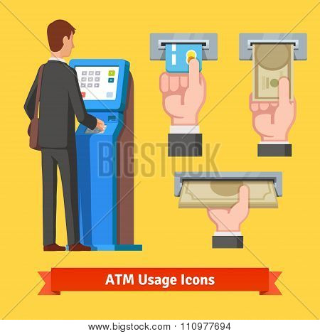 Businessman using modern ATM machine