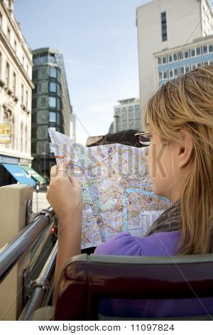 Woman Reading Map on Bus