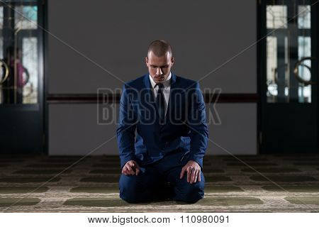 Humble Businessman Muslim Prayer In Mosque