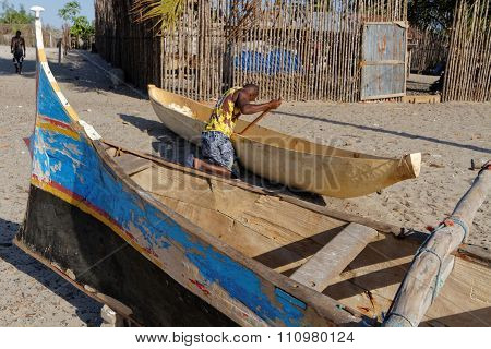 Belo, Madagascar, November 24, 2015 : Building Of A Traditional Pirogue On The Beach. The Outrigger