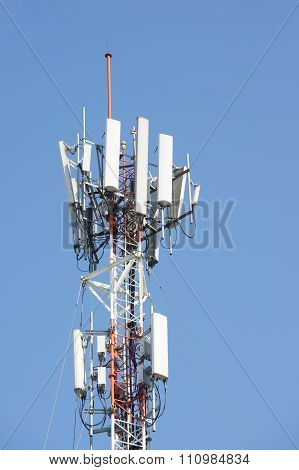 Antenna Cellular Mobile Phone Tower In Blue Sky