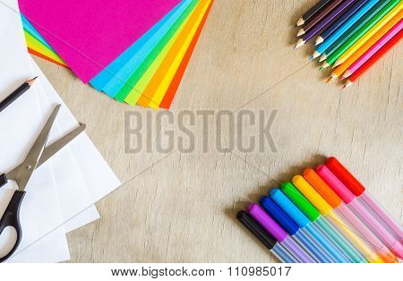 Colored Paper, Felt-tip Pens, Pencils And Scissors On Wooden Background