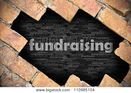 Hole In The Brick Wall With Word Fundraising