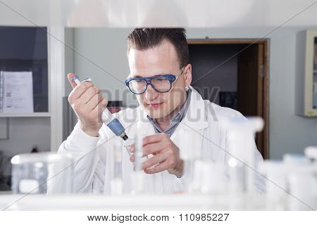 Scientist Works In Laboratory
