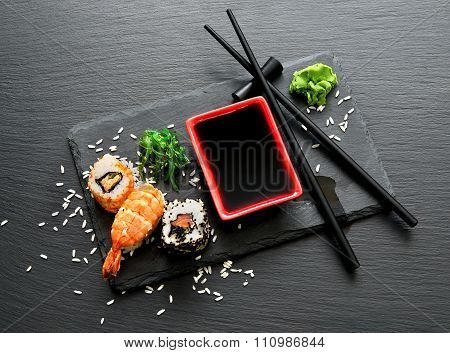 Delicious sushi with sauce