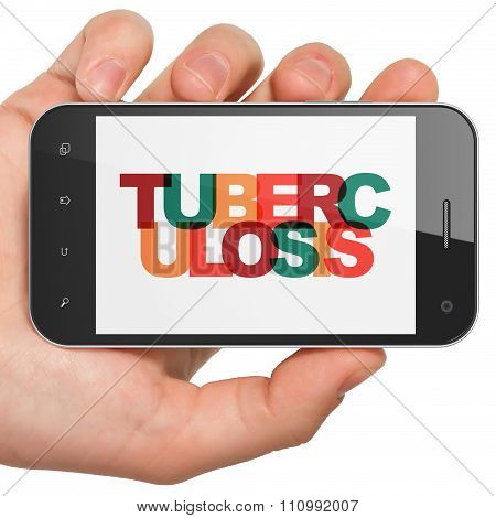 Medicine concept: Hand Holding Smartphone with Tuberculosis on  display