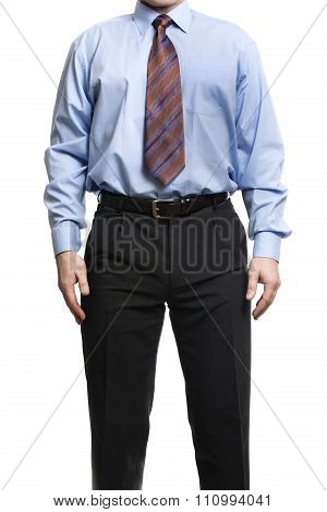 Businessman In Blue Shirt Stands With Hands On The Hips