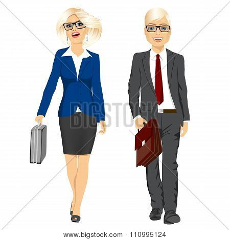 young business man and woman walking forward