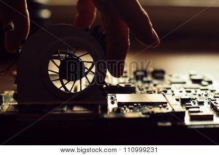Technician Repairing A Broken Computer