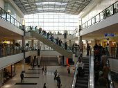 pic of shopping center  - shoppers in a big shopping center with elevators - JPG