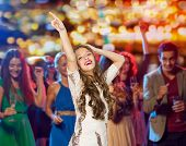 people, holidays and nightlife concept - happy young woman or teen girl in fancy dress with sequins  poster