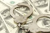 pic of snitch  - Handcuffs on money background - JPG