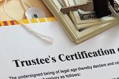stock photo of sanskrit  - Trustee certification abstract with dollars and key - JPG