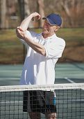 foto of tennis elbow  - Man in pain with elbow sports inquiry on tennis court - JPG