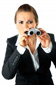 Interested modern business woman looking through binoculars isolated on white background