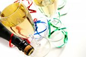 stock photo of birthday party  - champagne glasses and bottle on white background with ribbons - JPG