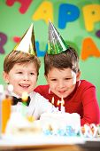 picture of birthday party  - Portrait of happy boys on birthday party with cake near by - JPG