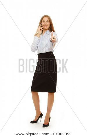 A young successful businesswoman talking on the phone and showing ok, isolated on white