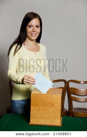 Women in the election with ballots and ballot box