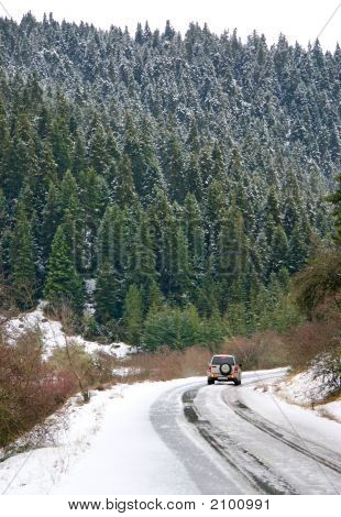 Winter Off-Road Adventure On Mountain Forest