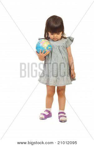 Toddler Meditating And Holding Globe