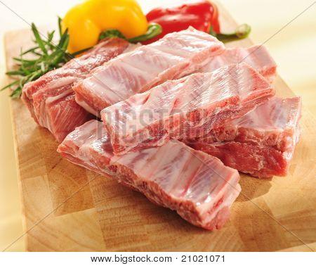 Raw Pork Ribs. Arrangement On A Cutting Board.