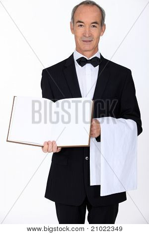 A waiter with a blank book