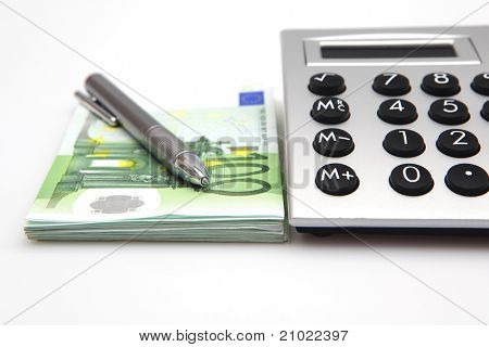 Calculator with euro bills and pen