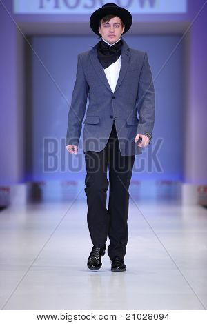 MOSCOW - FEBRUARY 22: A model wears a suit and hat from Slava Zaytzev and walks the catwalk in Collection Premiere Moscow, a leading fashion fair in Eastern European market, February 22, 2011 in Moscow, Russia.