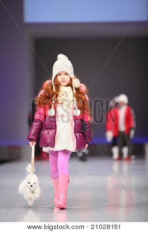 MOSCOW - FEBRUARY 22: An unidentified child model wear fashions from Snowimage and walks the catwalk in Collection Premiere Moscow, an international fashion fair for Eastern Europe, on February 22, 2011 in Moscow, Russia.