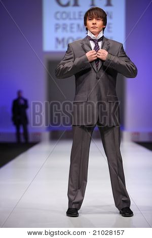 MOSCOW - FEBRUARY 22: A model wears a  gray suit from Slava Zaytzev and walks the catwalk in the Collection Premiere Moscow, leading fashion fair in Eastern European market, on February 22, 2011 in Moscow, Russia.