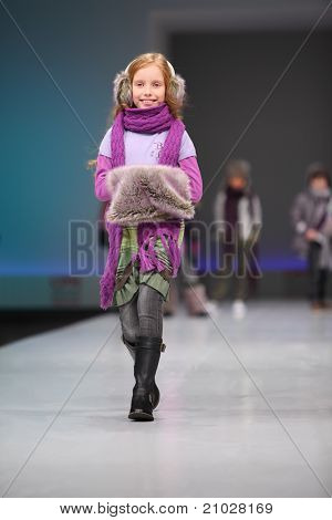 MOSCOW - FEBRUARY 22: An unidentified child model wear fashions by Snowimage and walks the catwalk in Collection Premiere Moscow, an international fashion fair for Eastern Europe, on February 22, 2011 in Moscow, Russia.
