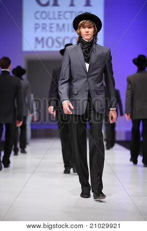 MOSCOW - FEBRUARY 22: A model wears a suit from Slava Zaytzev and walks the catwalk in the Collection Premiere Moscow, a leading fashion fair in Eastern European market, on February 22, 2011 in Moscow, Russia.