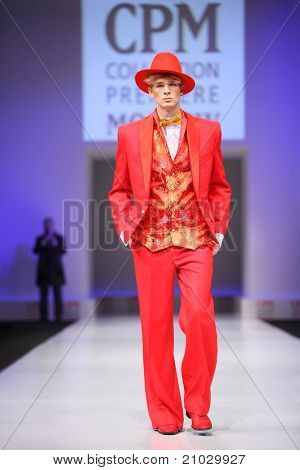 MOSCOW - FEBRUARY 22: A model wears a red suit from Slava Zaytzev and walks the catwalk in the Collection Premiere Moscow, a leading fashion fair in Eastern European market, February 22, 2011 in Moscow, Russia.