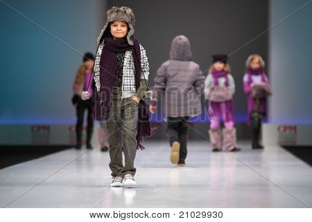 MOSCOW - FEBRUARY 22: Unidentified child models wear fashions by Snowimage and walk the catwalk in Collection Premiere Moscow, an international fashion fair for Eastern Europe, on February 22, 2011 in Moscow, Russia.