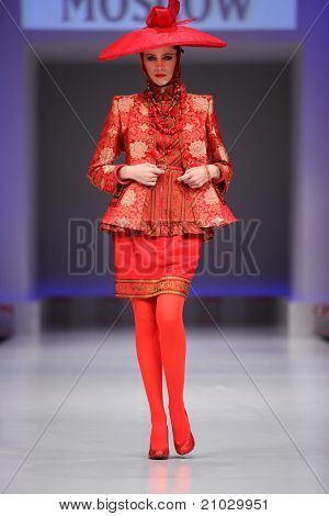MOSCOW - FEBRUARY 22: A model wears red suit from Slava Zaytzev and walks the catwalk in the Collection Premiere Moscow, a fashion industry platform of IGEDO Company, on February 22, 2011 in Moscow, Russia.