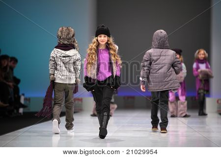 MOSCOW - FEBRUARY 22: Unidentified child models wear fashions from Snowimage and walk the catwalk in Collection Premiere Moscow, main platform of fashion industry in Eastern Europe, on February 22, 2011 in Moscow, Russia