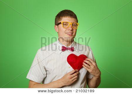 Smiling guy holding heart shape
