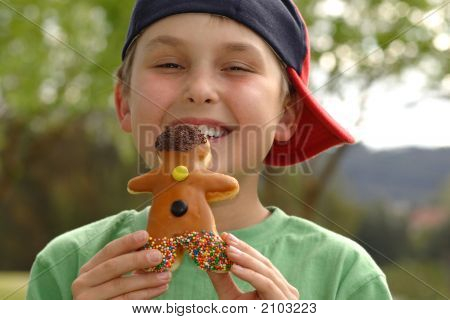Grinning  Boy With A Doughnut