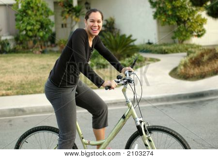 Young Woman Working Out On A Bike