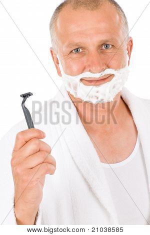 Male Cosmetics - Mature Man Shaving His Beard