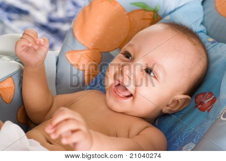 Smiling Newborn On A Bed