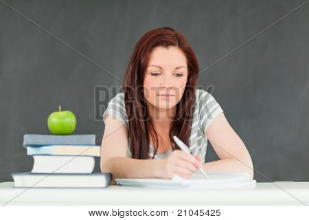Young Student Taking Notes