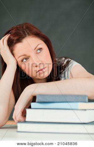 Beautiful Bored Student With Her Forearm On Her Books