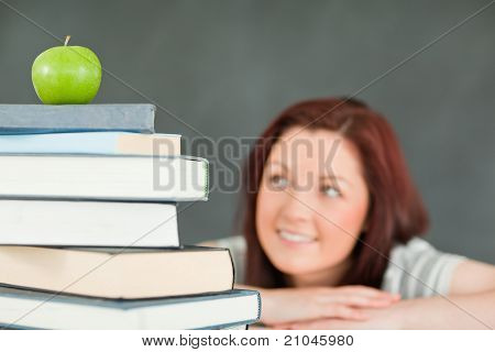Young Female Student With A Stack Of Books