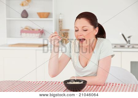 Good Looking Woman Posing While Eating A Bowl Of Pasta
